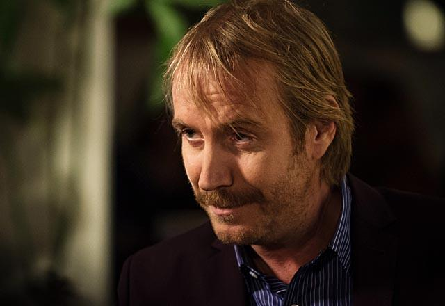 """Blood is Thicker"" --Mycroft (Rhys Ifans) makes a case for his brother Sherlock to move back to London, on ELEMENTARY, Thurs. Nov. 14 (10:01 ? 11:00 PM, ET/PT) on the CBS Television Network . Photo: Jeff Neumann /CBS ©2013 CBS Broadcasting, Inc. All Rights Reserved"
